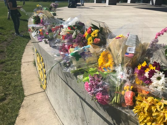 Community members brought flowers to Lake George Friday night for George Floyd.  The flower drop off was organized by UniteCloud, a local group which plans to bring the flowers to a memorial in Minneapolis Saturday.
