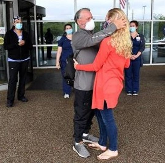Daniel Hickey reunites with his wife, Kellie, as he is discharged Friday from Inspira Medical Center Vineland. He spent six daysl receiving treatment, including convalescent plasma and Remdesivir, for COVID-19. CREDIT: Inspira Health Network.