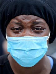 A woman cries as she joins protesters at Union Square in Manhattan on Saturday, May 30, 2020. Several thousand people rallied and marched through lower Manhattan to protest the death of George Floyd in Minneapolis earlier in the week.