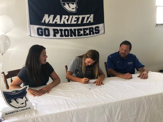 Melena Moore makes her commitment to Marietta College on Friday at her home near Zanesville. Moore was a first-team All-East District performer for Zanesville High School as a four-year letterman.