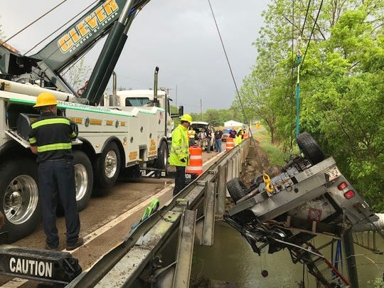 A Ford F30, driven by Mark Snode, crashed and overturned in a creek on Ohio 146 on Friday. Clever Towing helped pull the truck from the creek, as the road was closed for three hours.