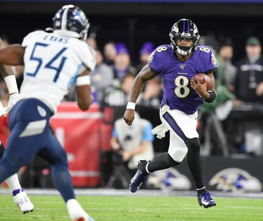 Baltimore Ravens quarterback Lamar Jackson (8) runs against the Tennessee Titans during the first quarter of the AFC Divisional Round matchup.