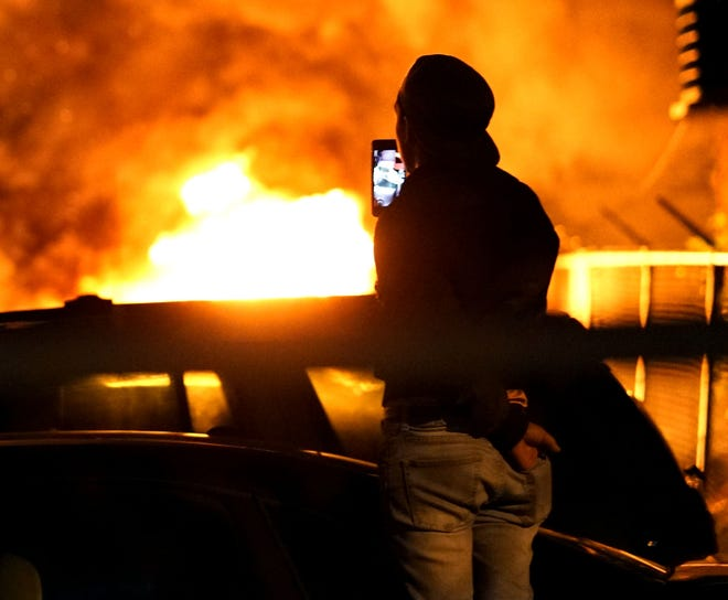 Several cars burn near a gas station during a night of rioting in Minneapolis over the death of George Floyd in police custody.