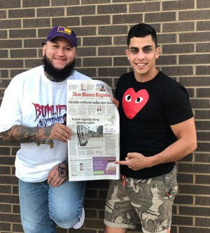 Kenny Serrano, left, and filmmaker Joe Massa hold an edition of the New Haven Register with a front page story about their Web series, My Suicide Story.