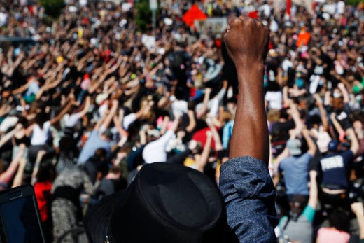 Protesters gather Saturday, May 30, 2020, in Minneapolis. Protests continued following the death of George Floyd.