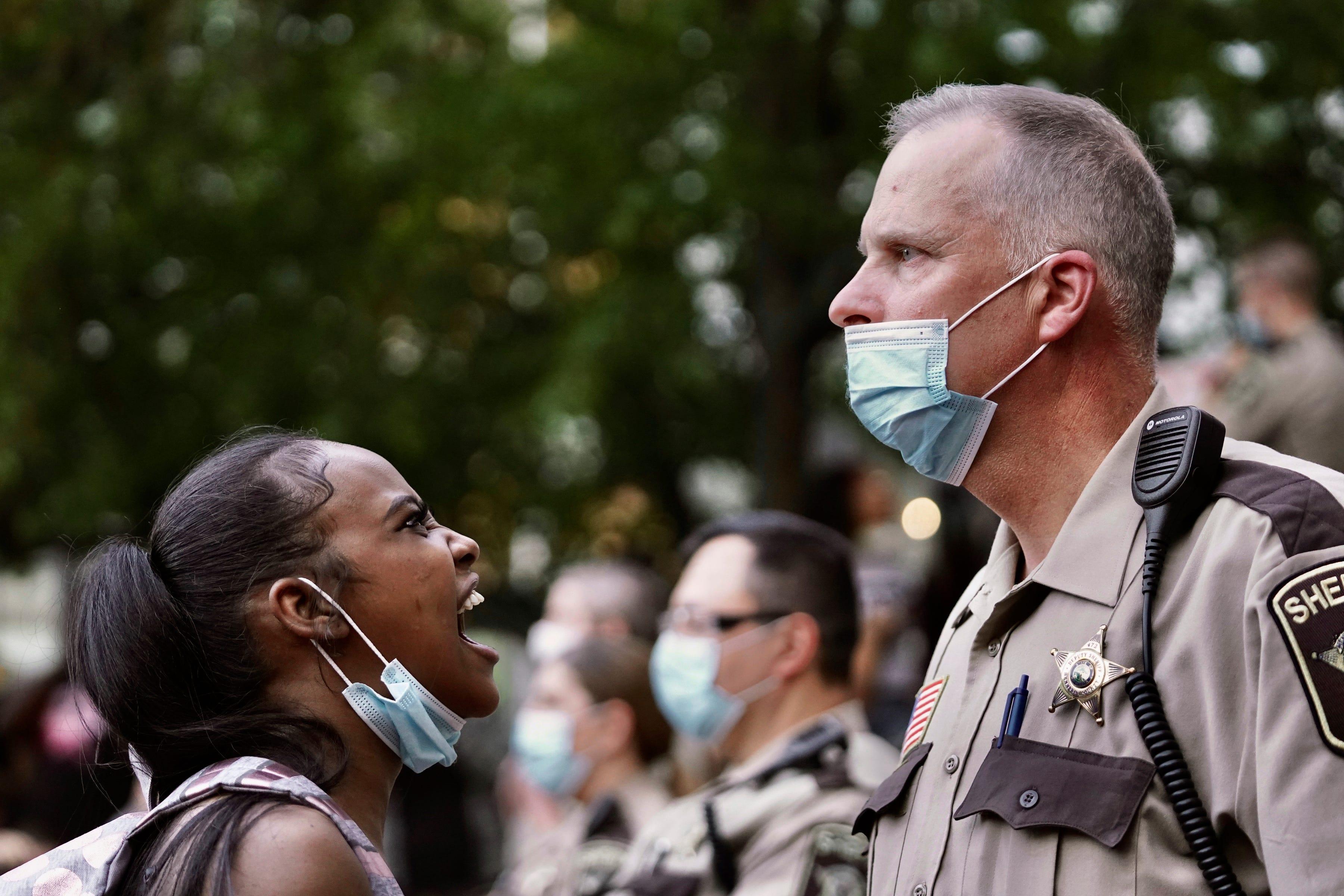 https://www.gannett-cdn.com/presto/2020/05/30/USAT/e6bbe41a-59ae-4823-88fb-b17167ce13e7-AP_APTOPIX_Minneapolis_Police_Death.jpg