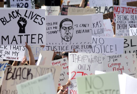 Protesters during a Black Lives Matter march and rally on Saturday, May 30, 2020, at Houdini Plaza in Appleton, Wis. Protests have been happening across the country this week, after George Floyd, a 46-year-old black man, was killed Monday by a white Minneapolis police officer who knelt on his neck while arresting him.Wm. Glasheen USA TODAY NETWORK-Wisconsin