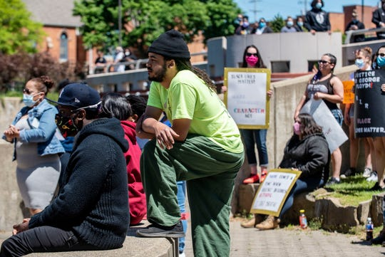 Battle Creek resident Devon Wilson joins a protest of George Floyd's death on Sunday, May 31, 2020 at Friendship Park in Battle Creek, Mich. Southwestern Michigan Urban League organized a gridlock of Capital Ave. and Michigan Ave., and community members spoke near the river.