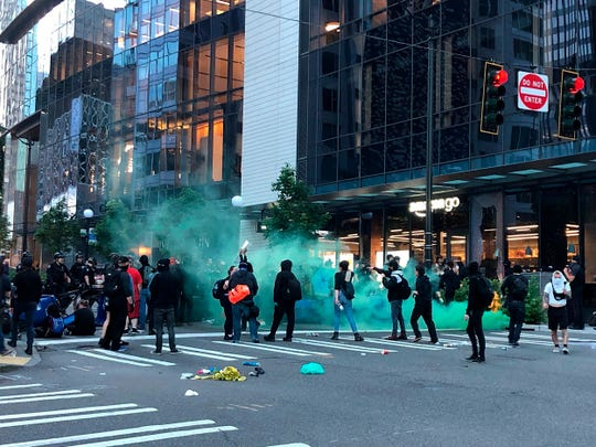 In this May 29, 2020, photo, demonstrators gather at 5th Avenue and Madison Street during a march in solidarity with Minneapolis and protesting police brutality in Seattle. Protests have been erupting all over the country after George Floyd died earlier this week in police custody in Minneapolis. (Amanda Snyder/The Seattle Times via AP)