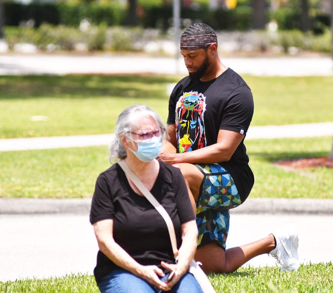 Jarvis James of Melbourne does not consider himself an activist, but wanted to do something peaceful about all the violence going on in cities over the death of George Floyd. He put a post on Facebook inviting people to come to the Moore Justice Center in Viera and take a knee for 10 minutes. No speeches, no bullhorns, just a non-violent 10 minute take a knee. At the end, some read quotes about racism off their phones or signs.