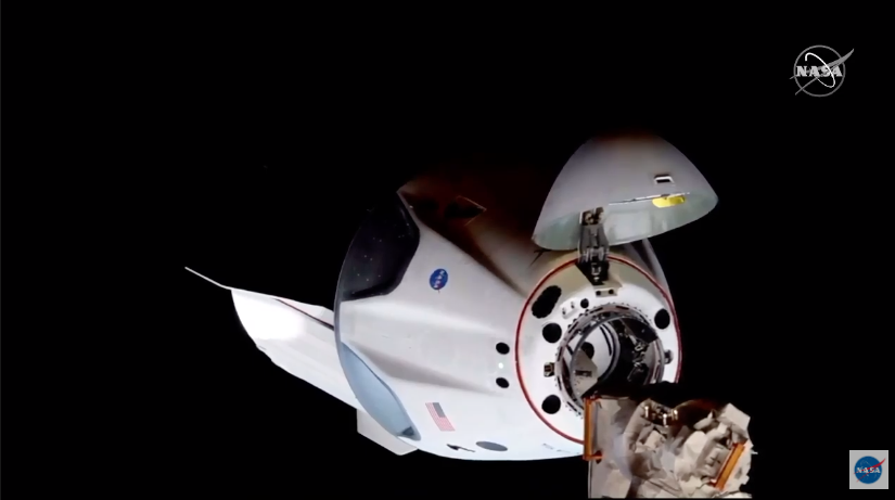 SpaceX Crew Dragon capsule carrying NASA astronauts docks with ISS