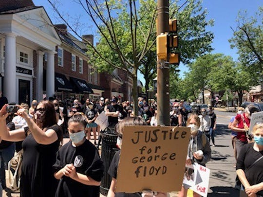 More than 300 residents of Haddonfield and surrounding communities peacefully demonstrate Sunday in Colonial downtown Haddonfield to support justice and protest violence against people of color following recent death of black victim George Floyd restrained by Minneapolis police last week.