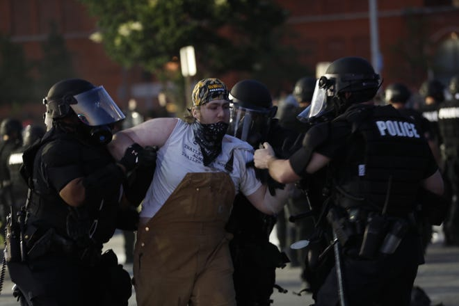 Protesters are arrested in Cincinnati May 30, 2020.