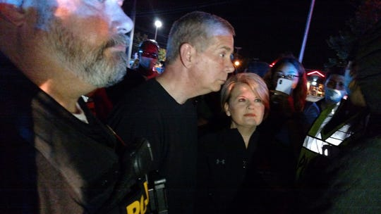 Clarksville Mayor Joe Pitts, with his wife, Cynthia, listens to protesters in the middle of Wilma Rudolph Boulevard on Saturday.