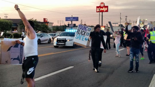The northbound lanes of Wilma Rudolph Boulevard were shut down Saturday night as people protesting the death of George Floyd spilled onto the highway.