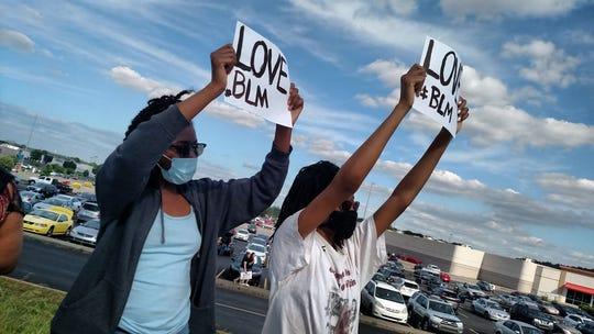 People line Wilma Rudolph Boulevard on Saturday night to protest the death of George Floyd.