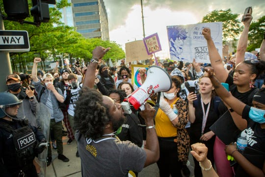 Protesters in downtown march and stop at the Detroit Police Station for a second night of protests in Detroit May 30, 2020. They were marching to protest police brutality and the death of George Floyd.