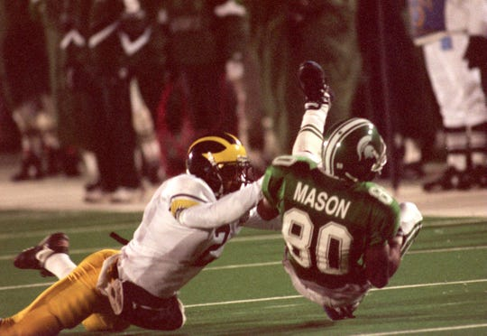 Derrick Mason comes up with the catch against Michigan's Charles Woodson in MSU's 1995 win.