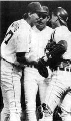 Jack Morris, left, is congratulated by first baseman Dave Bergman and catcher Mike Heath after Morris completed a one-hitter against the Royals at Tiger Stadium on July 6, 1990.