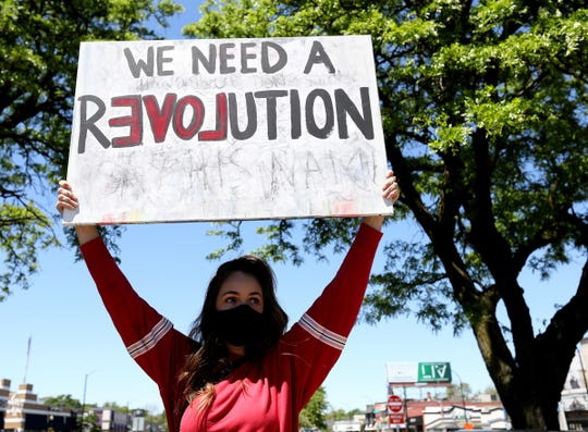 Angela Wright, 32 of Ferndale was one of around 200 people that stood and the intersections of Woodward Avenue and 9 Mile on Sunday, May 31, 2020 to protest and remember George Floyd.