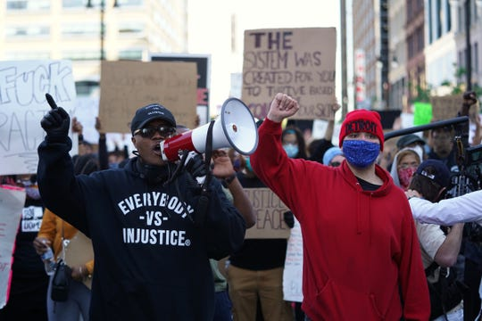 Protestors march through downtown Detroit on May 31, 2020, during the third day of protesting against police brutality in the city.