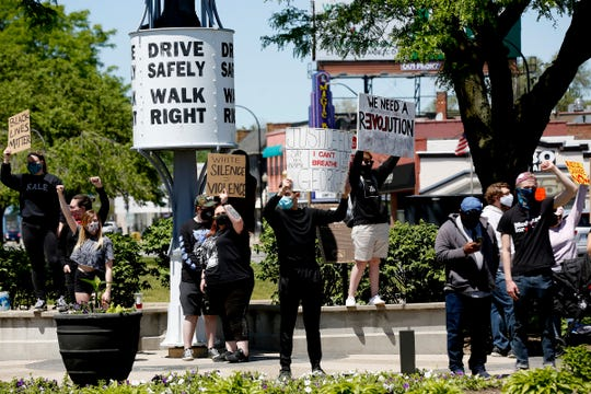 Around 200 people stood and the intersections of Woodward Avenue and 9 Mile on Sunday, May 31, 2020 to protest and remember George Floyd.