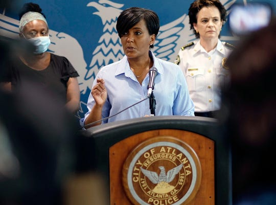 Atlanta Mayor Keisha Lance Bottoms announces a 9 PM curfew as protests continue for a second day over the death of George Floyd, Saturday. (Ben Gray/Atlanta Journal-Constitution via AP)