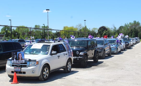 Cars line up at Fremont Ross High School prior to riding single file in a parade route through the city Sunday for the school's 2020 commencement ceremony.