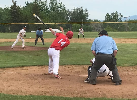 Lewistown's Lane Melton raps a single past Great Falls reliever Andrew Paradise, driving in two runs in the top of the ninth that was the difference in the Redbirds' 10-8 victory over the Chargers Saturday at Don Olson Field.