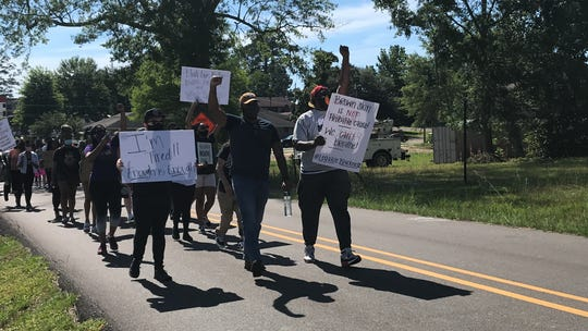 Protesters marched through midtown Hattiesburg, Miss., on Sunday, May 31, 2020, to protest the death of George Floyd in Minneapolis.