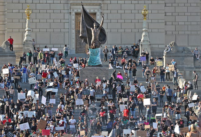 Protesters gather at the Indiana War Memorial downtown on Saturday, May 30, 2020.