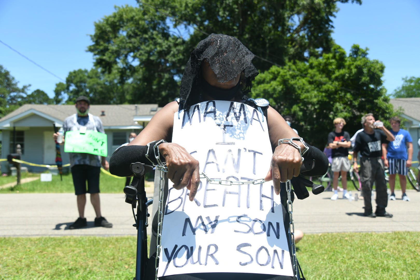Petal, Miss., resident Lorraine Bates, in mourning attire, attends the third day of protests calling for Mayor Hal Marx's resignation on May 31, 2020.