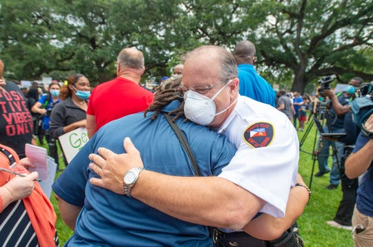 Lafayette Police Chief Scott Morgan hugs Marja Broussard, who leads Lafayette's NAACP chapter as Protesters rally in solidarity with those in Minnesota over the killing of George Floyd by police in Lafayette, LA. Sunday, May 31, 2020.