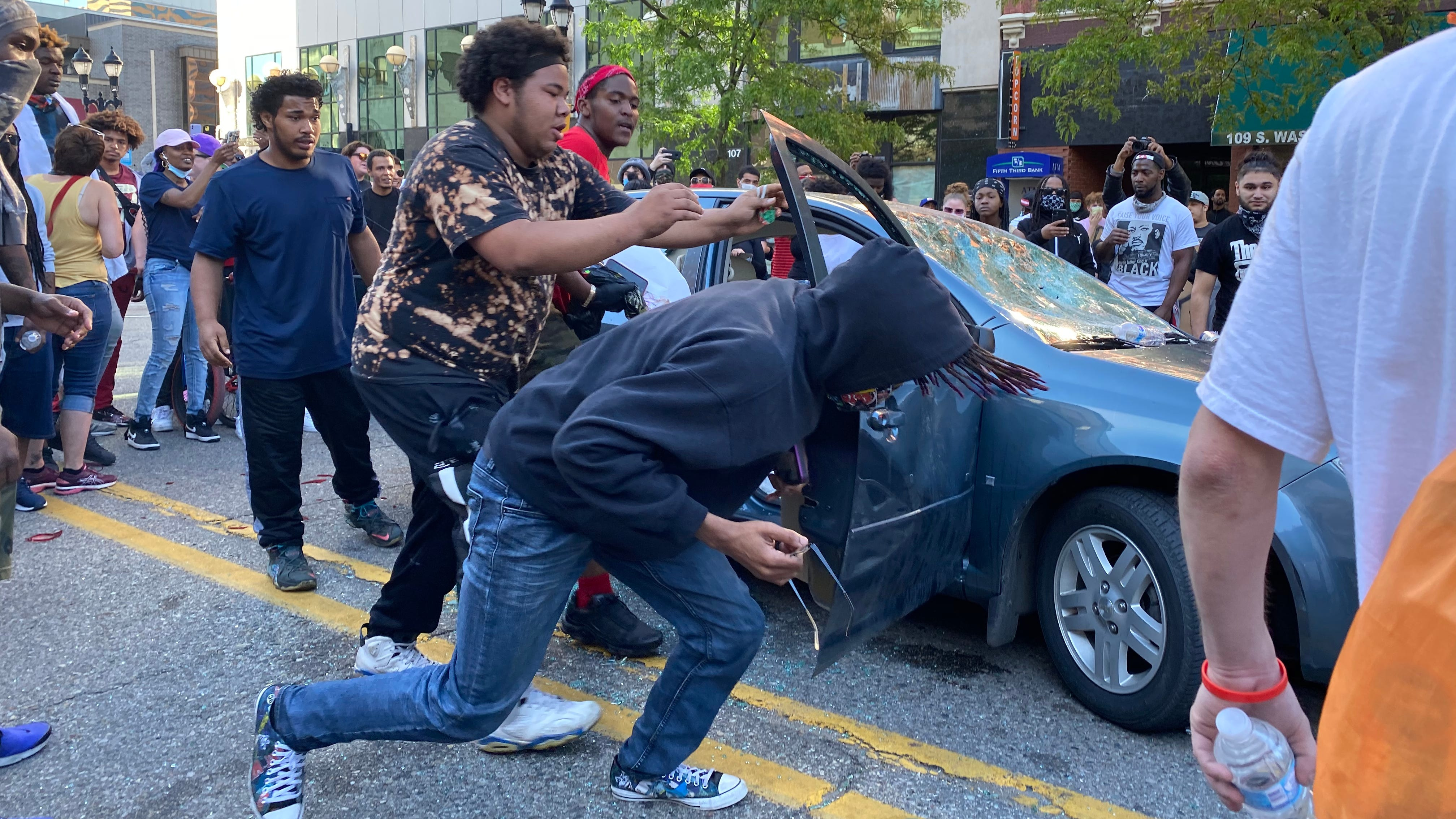 Videos: Woman drove through crowd, nearly hit marchers during protest