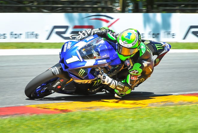 Leader Cameron Beaubier leans his bike into Turn 6 in the Superbike race Sunday at Road America.