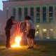 Protesters bun a flag in front of Nashville's Metro Courthouse