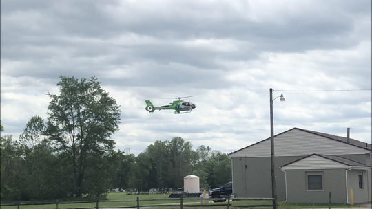 A MedFlight emergency helicopter arrives in Newark on Saturday to transport a patient to a Columbus hospital after a two-vehicle crash on Cedar Run Road injured four.