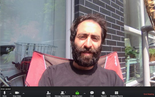 Las Cruces native Amer Jandali prepares for a Zoom meeting on his balcony in Brooklyn, New York. Jandali has been working from his apartment since March 20, when Gov. Andrew Cuomo's office issued an executive order closing down nonessential businesses due to the COVID-19 pandemic.