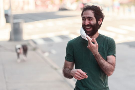 Las Cruces native Amer Jandali puts on a face mask while standing on the empty sidewalks of Brooklyn, New York, during the COVID-19 pandemic on May 3, 2020. Jandali recently began selling cotton masks at www.futuremeetspresent.com; he donates 50 percent of the proceeds to nonprofit organizations.