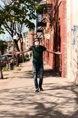 Las Cruces native Amer Jandali, donning a face mask, walks down the otherwise empty sidewalks of Brooklyn, New York, during the COVID-19 pandemic on May 3, 2020.