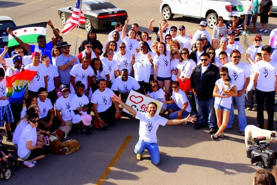 Amer Jandali poses at Mesilla Valley Mall with participants of the Freedom Walk he organized in 2013. The march was designed to raise awareness about human rights violations under the Bashar al-Assad regime.