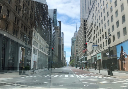 Fifth Avenue in Manhattan is empty on Sunday, May 24, 2020. Ordinarily, it would be bustling on Memorial Day Weekend, but the city is under a stay-at-home order to mitigate the spread of COVID-19.