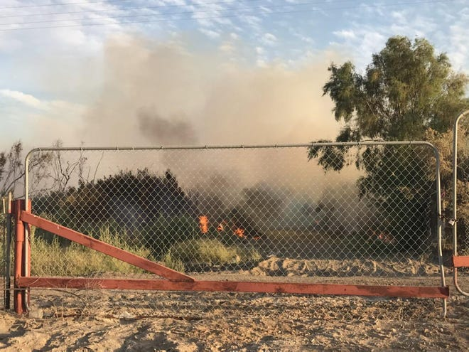 The fire burned 42 acres as of 8 p.m. Saturday, officials said.