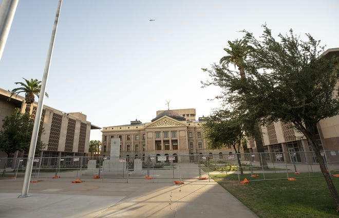 Fencing surrounds the Arizona state Capitol on May 30, 2020, to protect it from protesters.