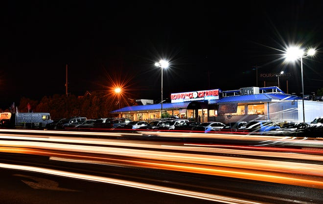 A long exposure shows Route 30 traffic passing a busy Round the Clock Diner in Manchester Township, Saturday night, May 30, 2020. Dawn J. Sagert photo