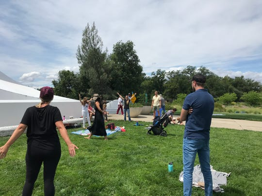 A small group of people gathered Sunday to pray for peace and unity near the Sundial Bridge in Redding.