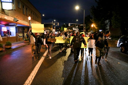 Protesters demonstrating against police brutality march in the street in Salem, Oregon, on May 30, 2020.