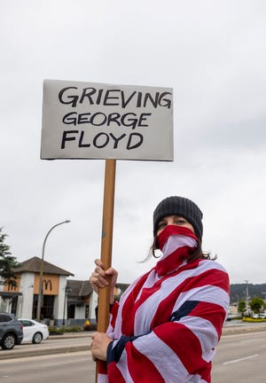 "Hundreds gathered in Monterey, Calif, in solidarity during a ""Call for Justice"" demonstration after the murder of George Floyd at the hands of a police officer on Saturday, May 30, 2020."