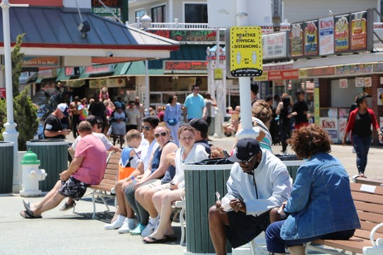 Crowds enjoy the sun and beach at the Ocean City Boardwalk on May 31, 2020, the weekend after Memorial Day. Most visitors didn't wear masks and crowded together at city benches and throughout the Boardwalk.