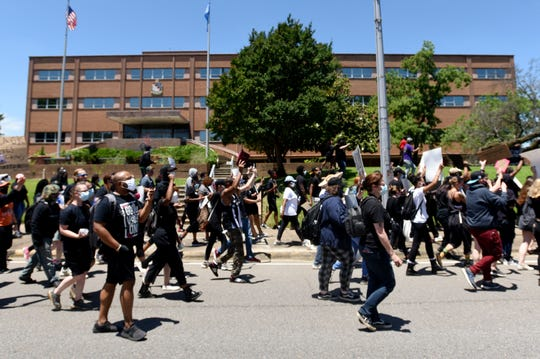 Protesters march in front of the Shreveport Police Station on Sunday afternoon, May 31, 2020. People gathered in front of the bus station across the street from the police department and marched to the Caddo Parish Courthouse for a Black Lives Matter demonstration.